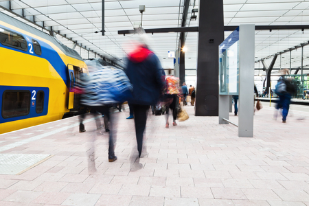 commuters at a train station