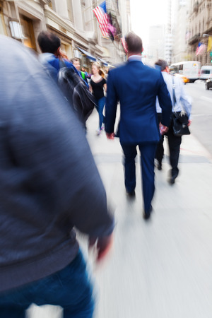 move in: picture with creative zoom and blur effect made by camera of businessman on the move in the city Stock Photo