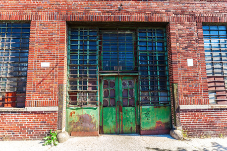 factory: Gate of an old factory in the Bronx, NYC Stock Photo