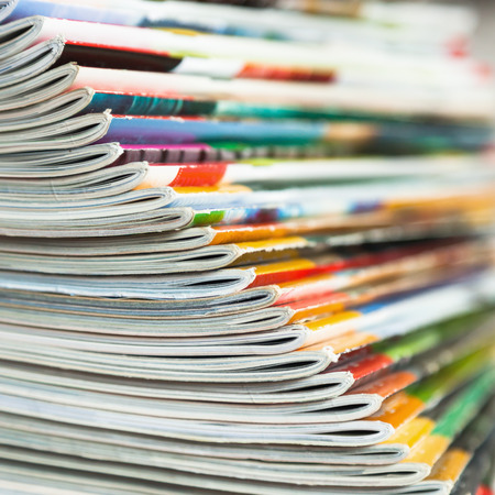 the edge: edge of fanned out magazines Stock Photo