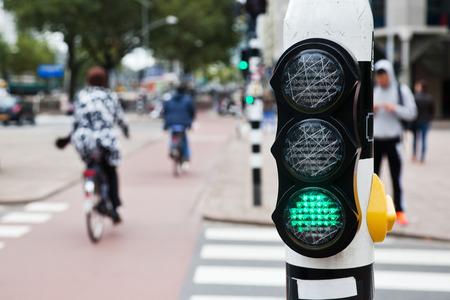 pedestrian: green pedestrian light at a pedestrian crossing