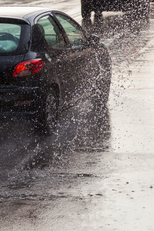bad weather: Traffic on a rain wet street Stock Photo