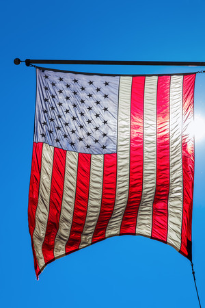 sunshine state: US flag in backlit Stock Photo
