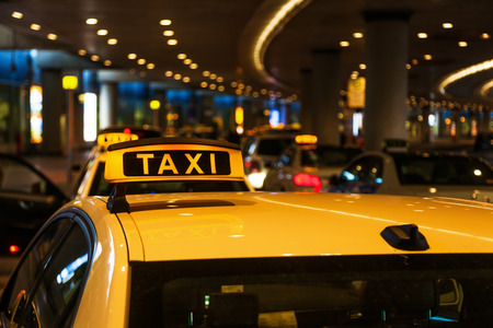 night picture of a taxi at an airport