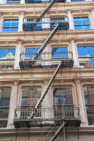 soho: old building with fire escape stairs in Soho, NYC