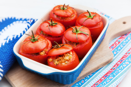 filled: casserole with baked tomatoes filled with parsley, bread crumbs, onion, mushrooms, tomato flesh and grated Parmesan cheese