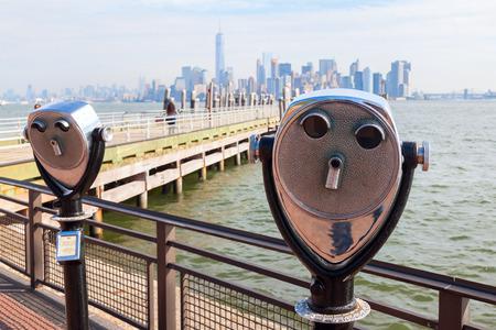 antique binoculars: Antique binoculars on Liberty Island with view to Manhattan, New York City Stock Photo