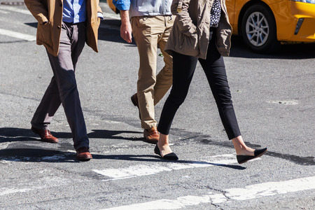 people crossing a street in New York City