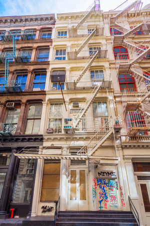 old new york: typical old building with fire escape ladders in Soho, Manhattan, New York City Stock Photo
