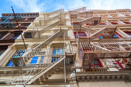 soho: typical old building with fire escape ladders in Soho, Manhattan, New York City Stock Photo