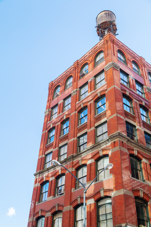 typical: old building in Manhattan, NYC, with typical water tank