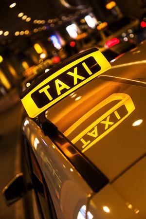 taxi at an airport at night