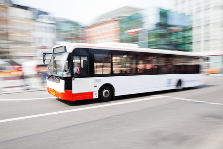motion: driving bus in city traffic in motion blur