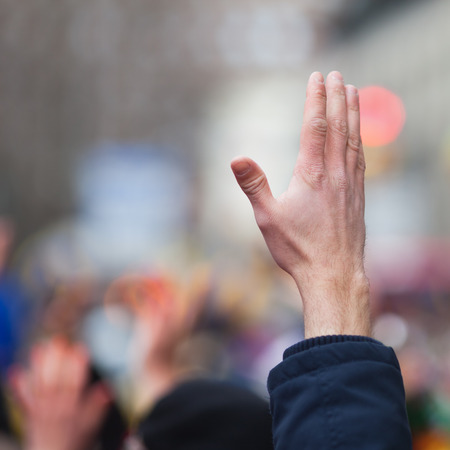 raised hand in the crowd