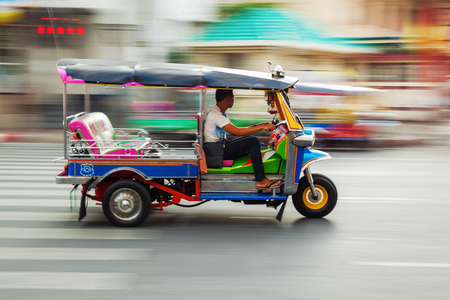 traditional tuk-tuk from Bangkok, Thailand, in motion blur Editorial