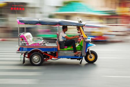 traditional tuk-tuk from Bangkok, Thailand, in motion blur Editoriali