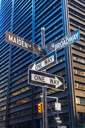 one lane street sign: street name signs at Broadway and Maiden Lane in Manhattan, NYC Editorial