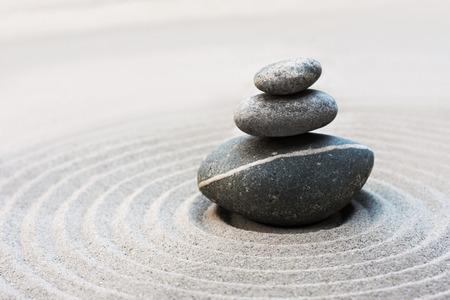 zen garden with stone stack