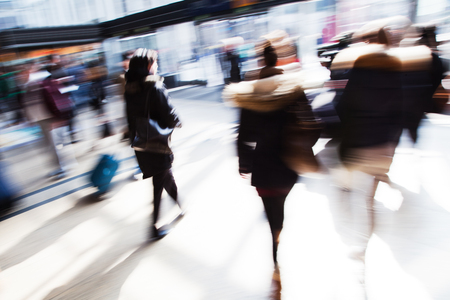 shadow woman: traveling people in motion blur at the railway station
