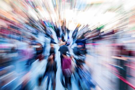 crowd of people in a city with creative zoom effect