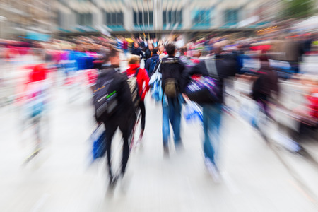 move in: picture with creative zoom effect of a crowd of people on the move in the city Stock Photo