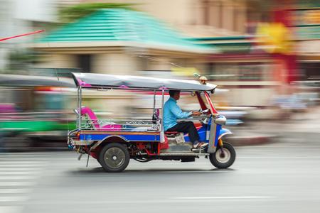 tuktuk: traditional tuk-tuk from Bangkok, Thailand, in motion blur Stock Photo