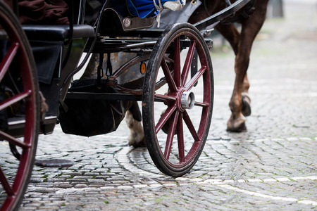 horse drawn: old horse drawn carriage on a cobblestone road