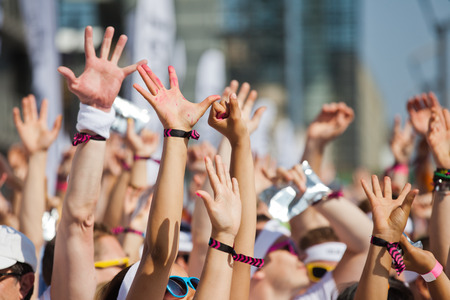 hand raising: crowd of people raising Their hands and have fun