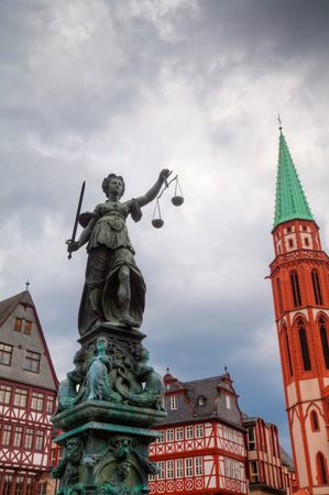 justice statue: old town with the Justice statue in Frankfurt, Germany