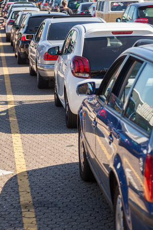 queue of cars at a ferry port Stock Photo