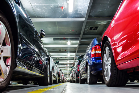 rows of parked cars on a ferry ship