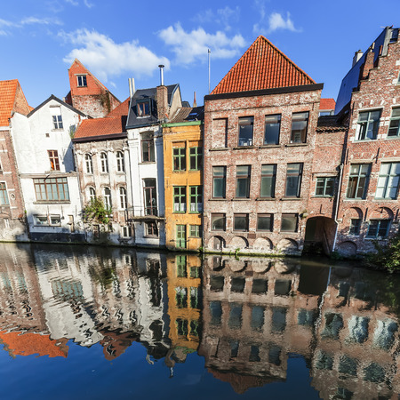 historical reflections: old buildings at a canal in Ghent, Belgium