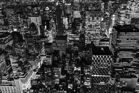 city lights: black and white picture with at aerial view of Manhattan, NYC, at night