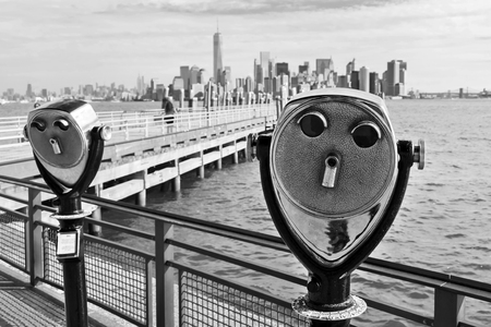 antique binoculars: black and white picture of antique binoculars on Liberty Iceland with view to Manhattan, New York City