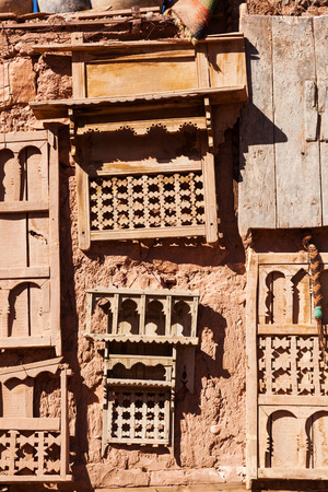 mud house: mud walled house in Morocco with antiquities hanging at the wall