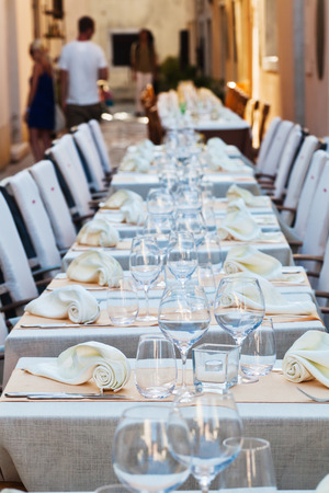 laid: ready laid table from a outdoor restaurant Stock Photo