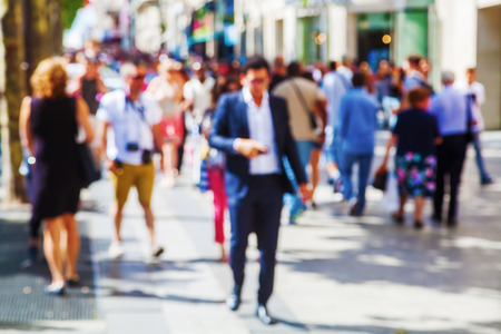 out of focus picture of a crowd of people walking in the city Stock Photo