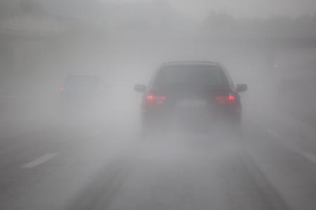 fog: freeway traffic with heavy rain