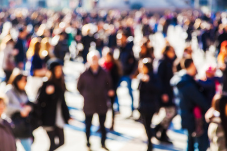 mass of people on a city square out of focus Archivio Fotografico