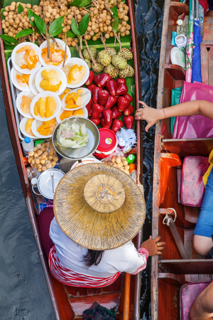 aerial view of a selling woman at the floating market Damnoen Saduak in Bangkok, Thailand Stock Photo