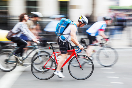 bicycle riders on a city street in motion blur Zdjęcie Seryjne