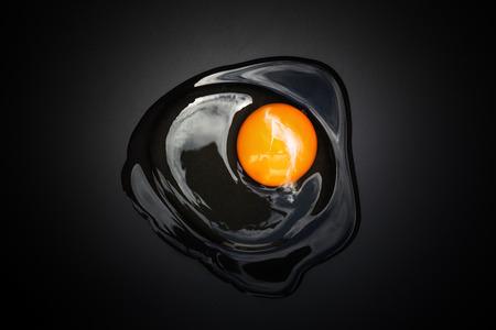 whipped egg on black surface