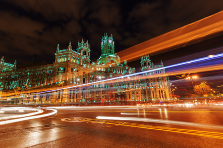 cibeles: Palacio de Cibeles at the Plaza de Cibeles with light trails of the traffic at night, Madrid, Spain