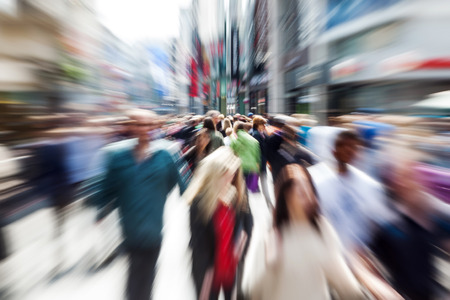 picture of moving people in the pedestrian area of ??the city with zoom effect