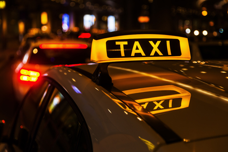 taxi sign: taxi cars at night