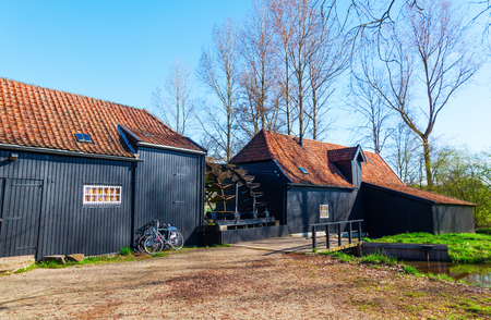 molino de agua: Watermill at Kollen nearby Nuenen, The Netherlands, where Van Gogh lived, he painted also this historic mill Foto de archivo