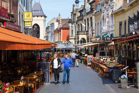 limburg: Valkenburg, Netherlands - April 11, 2016: city view with restaurants and unidentified people in the old town of Valkenburg. Valkenburg aan de Geul in the province Limburg is a popular tourist destination Editorial