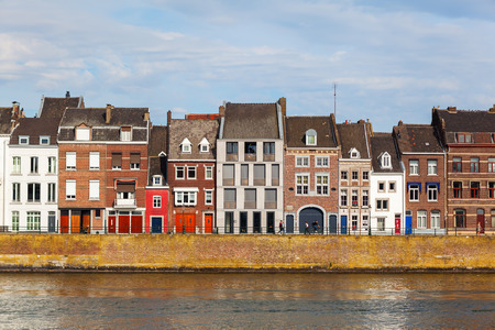 meuse: Maastricht, Netherlands - April 11, 2016:cityscape of Maastricht along the river Meuse, with unidentified people. Maastricht is a university city and the capital of the Dutch province Limburg Editorial