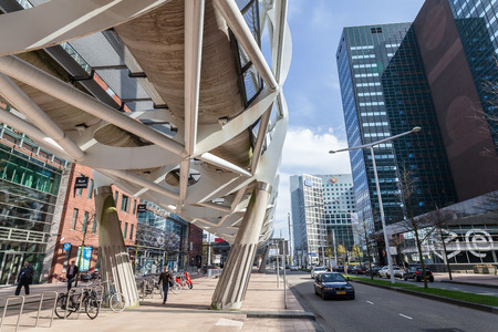 The Hague, Netherlands - April 21, 2016: Netkous viaduct at Beatrixkwartier with RandstadRail station and unidentified people. It is a modern construction designed by Zwarts & Jansma architects Publikacyjne