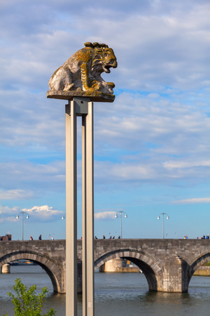 meuse: Maastricht, Netherlands - April 11, 2016: lion sculpture at the river Meuse in Maatricht. Maastricht is a university city and the capital of the Dutch province Limburg Editorial